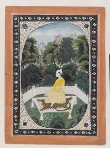 Man meditating in a garden